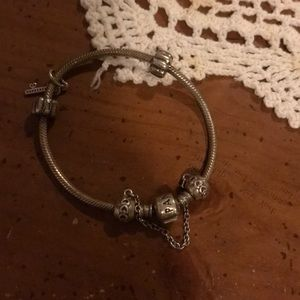 Older, new pandora bracelet with charms included.